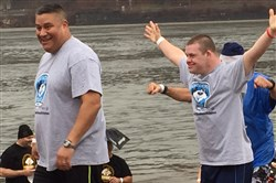 Lt. Matt Porter of the Port Authority Police and Special Olympian Michael Maker, 23, celebrate after making the Pittsburgh Polar Plunge in the Ohio River on Saturday.