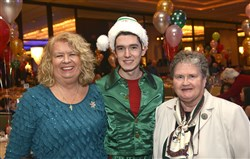 Joan Mills, manager of A Child's Place at Pittsburgh Mercy Health System poses with an elf, played by Peter Hughes and Sister Susan Welsh, right, president and CEO of Pittsburgh Mercy Health System.