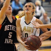 Norwin's Amanda Batey drives against Bethel Park's Cailey Klink during a game on Dec. 08, 2014.