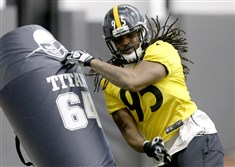 Jarvis Jones runs through a drillWednesday during practice at the Steelers South Side training facility.