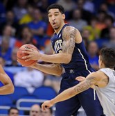 Pitt's Cameron Wright steals the ball from Colorado's Askia Booker in the first half of the second round of the NCAA tournament at the Amway Center in Orlando in March.