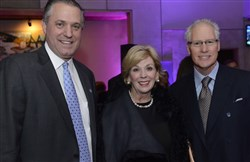 Jay Cleveland Jr., left, with Diane and Clifford Rowe Jr., at Children's Hospital of Pittsburgh of UPMC cocktail party at the W Hotel in New York City.