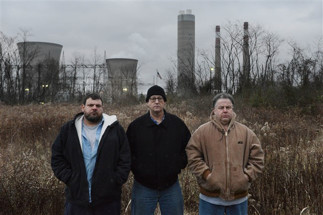 From left, former Hatfield's Ferry Power Station employees Andy Sinclair, Butch DiBease, and Derek Santini in front of the now-closed station in Masontown.