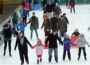Skaters take to the ice during a public skate at the Schenley Park rink earlier this month.