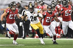 The Steelers' Le'Veon Bell picks up a first down during Sunday's game against the Falcons in the Georgia Dome in Atlanta. The Steelers won, 27-20.