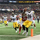 Le'Veon Bell scores a touchdown against the Falcons late in the fourth quarter.