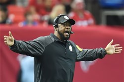 Steelers head coach Mike Tomlin argues a call Sunday at the Georgia Dome in Atlanta.