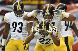 The Steelers' William Gay (no. 22) celebrates after a pick six against the Falcons Sunday at the Georgia Dome in Atlanta.