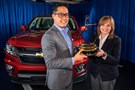 "Motor Trend Editor-In-Chief Edward Loh (left) presents General Motors CEO Mary Barra with the 2015 Motor Trend Truck of the Year Award for the 2015 Chevrolet Colorado. Motor Trend makes the announcement Wednesday, December 3, 2014, noting the 2015 Colorado emerged as Motor Trend's Truck of the Year by a rare unanimous vote. The editors were impressed with Colorado's clean-sheet design, ""right-sized"" package, excellent handling, and overall capability. (Photo by Steve Fecht for Chevrolet)"