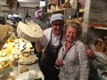 Eros Buratti with tour guide Anna Maria Massimi in his meat and cheese shop in Verbania, Italy.