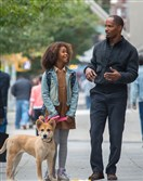 "Quvenzhane Wallis and Jamie Foxx in the remake of ""Annie."""