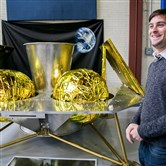 John Thornton, CEO of Astrobotic, stands in front of the company's Griffin Lander at its headquarters in the Strip District.