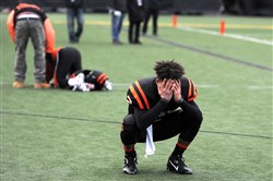 Emotions get the best of Clairton quarterback Ryan Williams  after losing to Bishop Guilfoyle in the PIAA Class A championship game at Hersheypark Stadium last Friday.