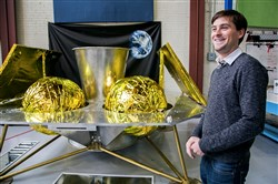 John Thornton, CEO of Astrobotic, stands in front of the company's Griffin Lander at their headquarters in the Strip District.