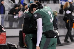 Pine-Richland quarterback Ben DiNucci (3) and D'ondre Gastion console each other after losing to St. Joseph's Prep in the PIAA Class AAAA championship Saturday at Hersheypark Stadium.
