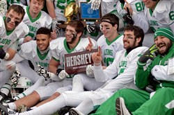 South Fayette teammates pose for photos after defeating Dunmore in the PIAA Class AA championship game at Hersheypark Stadium in December.
