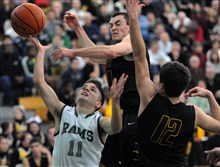 Pine-Richland's  Paul Nussbaum shot is swatted away by North Allegheny's Keegan Phillips as the Tigers'  Ethan Maenza looks on.