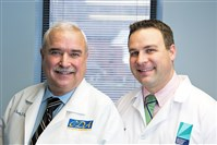 John Chips, left, with his son Tim at their dental practice in Ross.