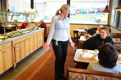 Abbey Stokes Miller, manager of Eat'n Park, talks with customers, Rhonda Liptak, 48, of Elizabeth and her mom, LaRue, 67, of McKeesport, at the restaurant Dec. 18.