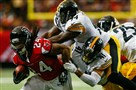 Devonta Freeman of the Atlanta Falcons rushes against Lawrence Timmons and Antwon Blake of the Steelers at the Georgia Dome on Dec. 14.