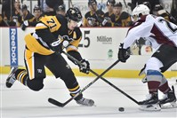 Evgeni Malkin makes a move around Colorado's Nick Holden as the Pens take on the Avs at Consol Energy Center.
