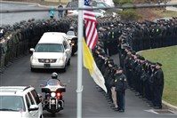 The funeral procession for Perryopolis Police officer Richard Champion leaves the Holy Trinity Church in Ligonier after his service. Officer Champion died in a car crash while on duty.