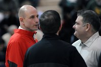 Stu Lyon, left, speaks with other Fox Chapel staff members before a recent game.