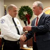 Murrysville Councilman Rege Synan, right, congratulates Medic One administrative director Darrick Gerrano on the 2014 Community Service award that the municipality gave to Medic One.