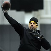 Offensive coordinator Todd Haley throws a pass as the Steelers practice at  their South Side training facility on Nov. 26.