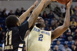Pitt's Michael Young drives to the net against Oakland's Nick Daniels in the first half at the Petersen Events Center Saturday.