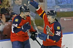 Jussi Jokinen, right, celebrates with Panthers teammate Brad Boyes Dec. 6. Jokinen is relied upon more in Florida, but in different roles than when he was with the Penguins.