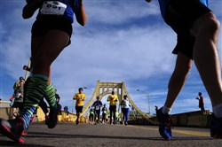 Participants run across the Andy Warhol Bridge during the 2013 Pittsburgh Marathon 5K Run on May 4, 2013.