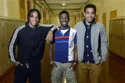 Jaquan Betts,17, left, Marcus Brown, 15, center, a freshman, and Marlin Rainey, 17, a junior, are three from a team of Wilkinsburg High School students who learned multimedia and interview skills talking to role models and mentors while doing an oral history project for their community through the Crossing Fences project.