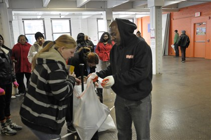"Staff Sergeant Eric Cheshier, of the U.S. Marine Corps, assists Nicole DeUsanio of Duquesne with toys, at the Toys for Tots campaign at the Guardian warehouse in the Strip District, Saturday afternoon. ""These people are wonderful,"" Ms, DeUsanio said."