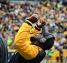 Coach Mike Tomlin celebrates a Steelers' touchdown during today's game against the Kansas City Chiefs at Heinz Field.