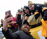 Steelers' Brett Keisel takes a selfie with fans before the start of today's game against the Kansas City Chiefs at Heinz Field.