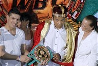 In this December 2012 file photo, the former heavyweight boxing champion Muhammad Ali, center, is crowned