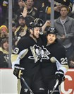 Penguins Nick Spaling and Steve Downiw celebrate a first-period goal Saturday night at Consol Energy Center.