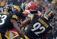 The Steelers' James Harrison takes down the Chiefs' Jamaal Charles on a fourth-down try near the end of the second quarter Sunday at Heinz Field.
