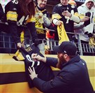 Brett Keisel signs autographs for fans before the Steelers-Chiefs game at Heinz Field.
