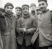 In this image provided by the Imperial War Museum, World War I German and British soldiers stand together on the battlefield near Ploegsteert, Belgium, during Decemer 1914. Soldiers who had been killing each other by the tens of thousands for months climbed out of their soggy trenches to seek a shred of humanity amid the horrors of World War I. Hands reached out across the divide and in Flanders Fields a century ago, a spontaneous Christmas truce ever so briefly lifted the human spirit.