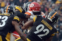 James Harrison takes down the Chiefs running back Jamaal Charles on fourth down near the end of the second quarter Sunday at Heinz Field.