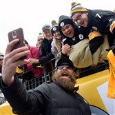 Brett Keisel, shown here taking a selfie with fans before December's game against Kansas City, spent 13 seasons with the Steelers.