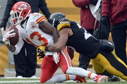 The Steelers' Mike Mitchell prevents the Chiefs' De'Anthony Thomas from getting a first down in the second quarter Sunday at Heinz Field.