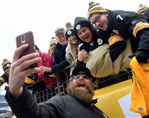 Steelers' Brett Keisel takes a selfie with fans before the start of today's game against the Kansas City Chiefs at Heinz Field. Kickoff is at 1 p.m.