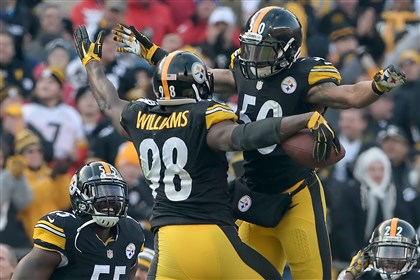 Steelers' Ryan Shazier congratulates Vince Williams after recovering a fumble against the Chiefs in the third quarter at Heinz Field Sunday.