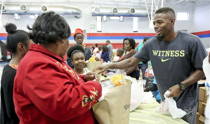 William Gay Steelers 112014 The Steelers' William Gay, right, hands out turkeys in November at Walker Ford Recreation Center in his hometown of Tallahassee, Fla. Mr. Gay was 7 when his mother was killed by his stepfather.
