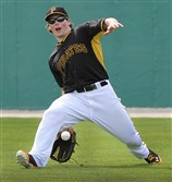 Pirates outfielder Travis Snider makes a between the legs catch during morning workouts at Pirate City in  Bradenton Florida.