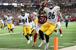 Le'Veon Bell scores a touchdown against the Falcons late in the fourth quarter Dec. 14.
