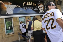 Pirates fans stand in line for will-call tickets before the first game of a double header at PNC Park in July 2013. The Pirates ticket sales team includes a lot of millennials.